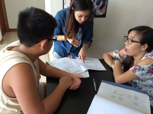 eduKate Tutor with Managers checking student progress for primary science papers from PSLE Syllabus examinations