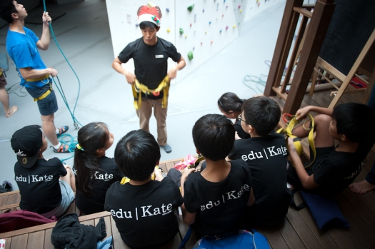 edukate students being taught awl climbing and safety
