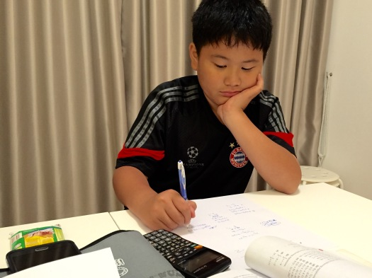 eduKate Singapore Punggol Tuition Centre Secondary 1 student doing Mathematics in Prive