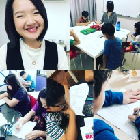 Tutor Yuet Ling doing what she loves, in class, making sure students have the best education available.