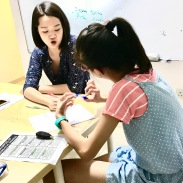 Tutor Yuet Ling teaching students and makes sure they understand their work