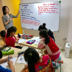 Tutor Yuet Ling in Creative Writing class, with air con and air filtered environment.